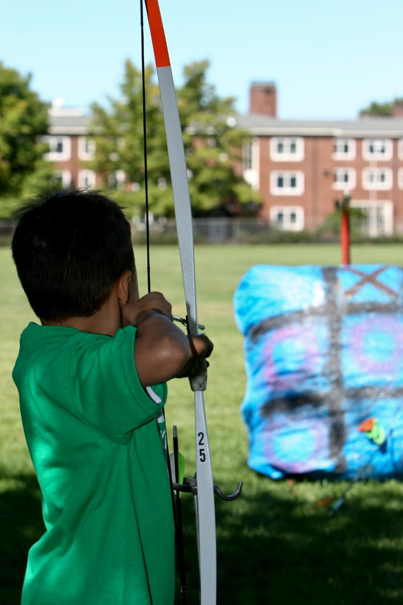child drawing a bow
