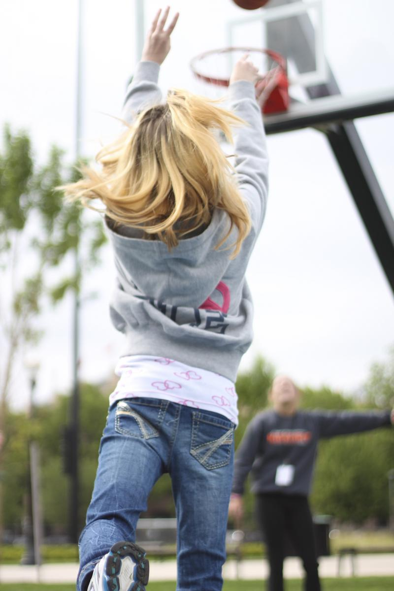 Luna watches Lauren working on her jump shot